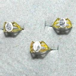 golden ring with scrimshaw ships in plastic